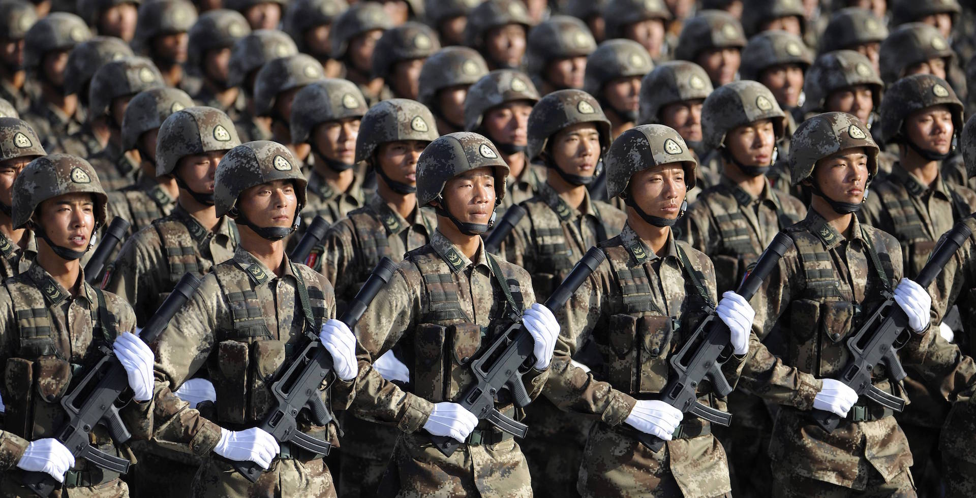 Soldiers from Chinese People's Liberation Army (PLA) Special Operations Forces march in formation during a training session at the 60th National Day Parade Village on the outskirts of Beijing in this September 15, 2009 file photo. China will beef up its military budget by 12.7 percent this year, the government said on March 4, 2011, a return to double-digit spending increases that will stir regional unease.   REUTERS/Joe Chan/Files (CHINA - Tags: MILITARY) CHINA OUT. NO COMMERCIAL OR EDITORIAL SALES IN CHINA