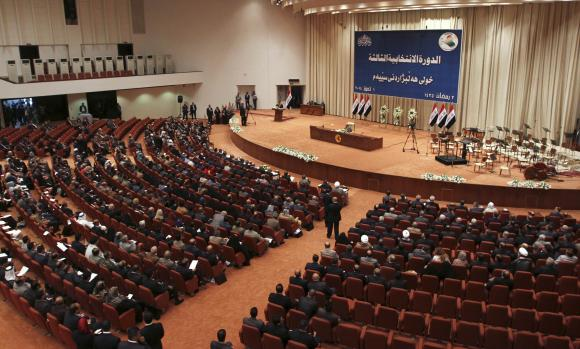 Members of the newly elected Iraqi parliament attend a session at the Parliament headquarters in Baghdad July 1, 2014. REUTERS/Stringer