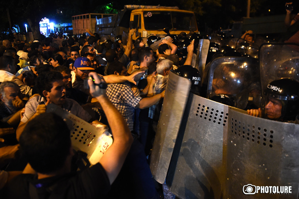 Clashes between policemen and protesting people took place during the protest action in support of initiators of occupation of the police station in Erebuni district in Yerevan, Armenia