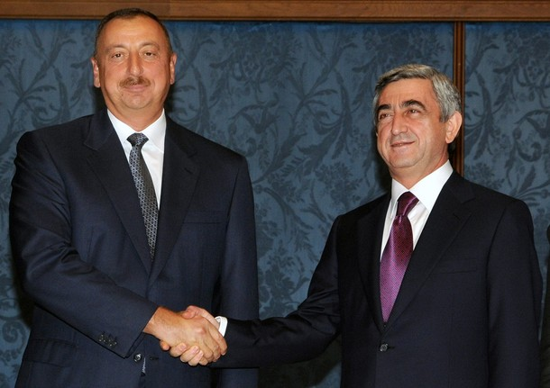Armenian President Serzh Sarkisian (L) shakes hands with his Azeri counterpart Ilham Aliyev in Moscow on July 17, 2009. Both presidents hold a preliminary meeting ahead of a Russia-brokered meeting with President Dmitry Medvedev scheduled for July 18.                     AFP PHOTO/ KAREN MINASYAN (Photo credit should read KAREN MINASYAN/AFP/Getty Images)