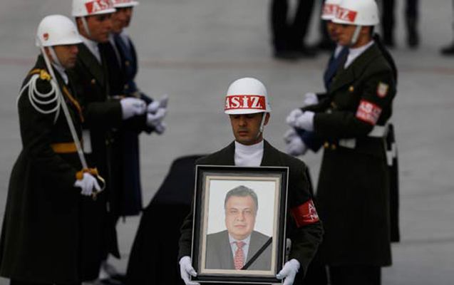 Honor guard holds a picture of late Russian Ambassador to Turkey Andrei Karlov during a ceremony at Esenboga airport in Ankara, Turkey, December 20, 2016. REUTERS/Umit Bektas