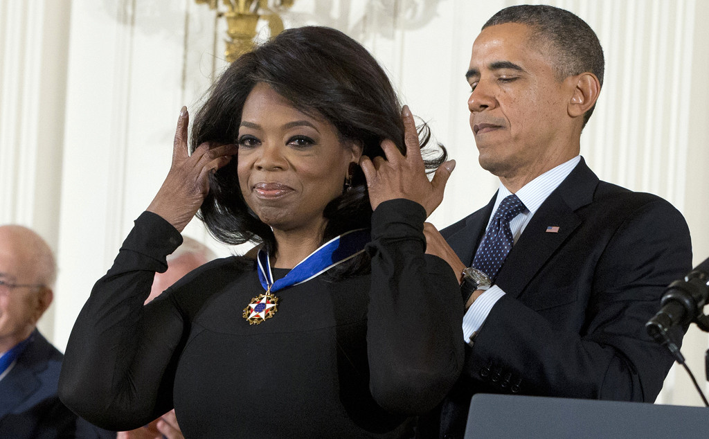 President Barack Obama awards Oprah Winfrey with the Presidential Medal of Freedom, Wednesday, Nov. 20, 2013, during a ceremony in the East Room of the White House in Washington. (AP Photo/ Evan Vucci)