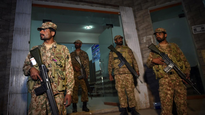 Pakistani soldiers stand guard at the entrance of a local hospital in the town of Sehwan, on February 17, 2017, a day after a bomb attack hit the 13th century Muslim Sufi shrine of Lal Shahbaz Qalandar in Sindh province, some 200 kilometres northeast of the provincial capital Karachi. Pakistan launched a nationwide security crackdown on February 17, officials said, after a bomb ripped through a crowded Sufi shrine killing at least 70 people including 20 children and wounding hundreds. Police had cordoned off the shrine of Lal Shahbaz Qalandar, a 13th century Muslim saint, early on February 16 as forensic investigators reached the town of Sehwan in Sindh province, some 200 kilometres (124 miles) northeast of financial hub Karachi. The Islamic State group (IS) has claimed the attack, which came after a series of bloody extremist assaults this week, including a powerful Taliban suicide bomb in the eastern city of Lahore which killed 13 people and wounded dozens. / AFP PHOTO / ASIF HASSAN