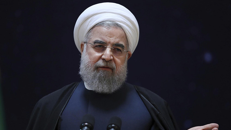 In this photo released by official website of the office of the Iranian Presidency, President Hassan Rouhani, speaks during a ceremony marking National Space Technology Day in Tehran, Iran, Wednesday, Feb. 1, 2017. President Hassan Rouhani has lashed out at the recent executive order by U.S. president Donald Trump to suspend immigration and visa processes for nationals from seven majority-Muslim countries, including Iran. (Iranian Presidency Office via AP)