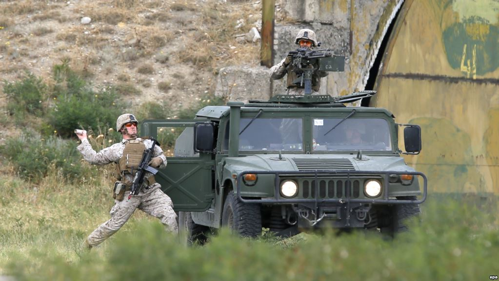 epa04855111 US soldiers with their High Mobility Multipurpose Wheeled Vehicles, better known by their short name 'Humwee', take part in the joint NATO-Georgia military exercise 'Agile Spirit 2015' at the military base of Vaziani, outside Tbilisi, Georgia, 21 July 2015. The 'Agile Spirit 2015' maneuvers gather troops from the USA, Georgia, Romania, Bulgaria, Lithuania and Latvia to exercise in support operations and peacekeeping simulations until 22 July 2015.  EPA/ZURAB KURTSIKIDZE