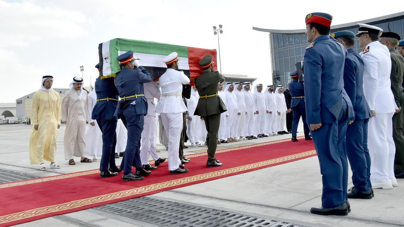 A handout image made available by the United Arab Emirates News Agency (WAM) on January 14, 2017 shows members of the Emirati armed forces carrying the coffins of officials who were killed in a bombing in the southern Afghan city of Kandahar, during an official repatriation ceremony at al-Bateen airport in Abu Dhabi. Five officials from the United Arab Emirates were among the dead in a bombing in the southern Afghan city of Kandahar, the Emirates' official WAM news agency said on January 11. The officials were