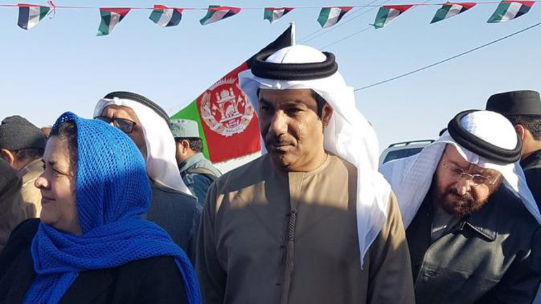 In this undated photo released by Official Twitter Account of the UAE Embassy in Kabul and made available Wednesday, Jan. 11, 2017, UAE Ambassador Juma Mohammed Abdullah al-Kaab, center, stands next to Nasrin Oryakhil, left, Afghanistan's minister of Labor, Social Affairs, Martyrs and Disabled, during an official ceremony of the Foundation for Khalifa bin Zayed Al Nahyan orphanage in Kandahar, Afghanistan. The UAE ambassador to Afghanistan was wounded and five of its diplomats were killed in a bombing in Kandahar, Afghanistan, the United Arab Emirates announced on Wednesday, Jan. 11, 2017. (UAE Embassy in Kabul via AP)