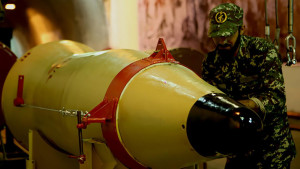 A handout picture released on March 8, 2016 by Sepah News, the online news site and public relations arm of Iran's Islamic Revolutionary Guard, shows a member of the Revolutionary Guards next to a missile launcher in an underground tunnel at an undisclosed location in Iran. Iran conducted multiple ballistic missile tests on March 8 in what it said was a display of
