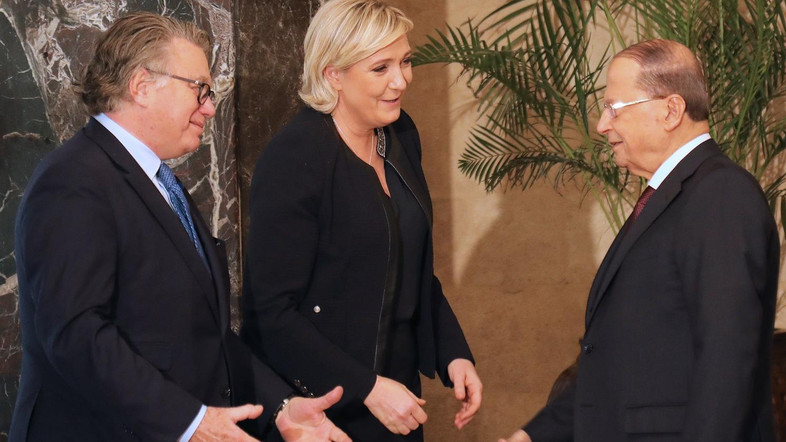 """France's far-right presidential candidate Marine Le Pen (C) and French MP Gilbert Collard  greet with Lebanese President Michel Aoun (R) at the Presidential palace of Baabda, on February 20, 2017. / AFP PHOTO / AHMAD ABDO / """"The erroneous mention[s] appearing in the metadata of this photo by Anwar Amro has been modified in AFP systems in the following manner: [ANWAR AMRO] instead of [AHMAD ABDO]. Please immediately remove the erroneous mention[s] from all your online services and delete it (them) from your servers. If you have been authorized by AFP to distribute it (them) to third parties, please ensure that the same actions are carried out by them. Failure to promptly comply with these instructions will entail liability on your part for any continued or post notification usage. Therefore we thank you very much for all your attention and prompt action. We are sorry for the inconvenience this notification may cause and remain at your disposal for any further information you may require."""""""