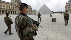 FILE PHOTO - French army soldiers patrol near the Louvre Museum Pyramid's main entrance in Paris, France, June 13, 2016.  REUTERS/Philippe Wojazer/File photo