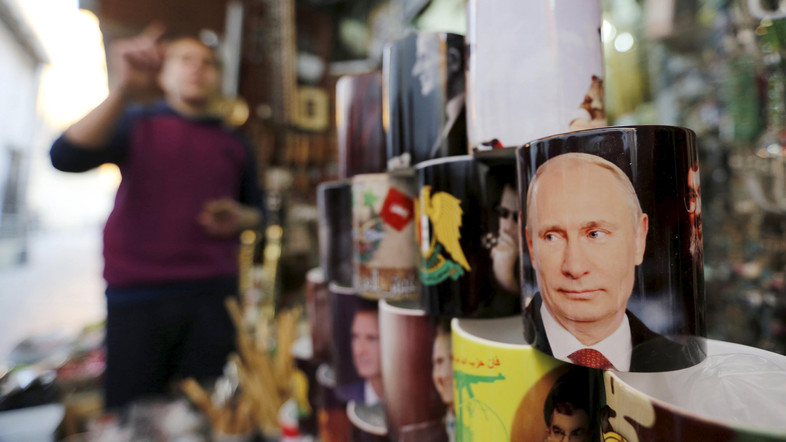 Souvenir mugs featuring Syria's President Bashar al-Assad, Russia's President Vladimir Putin and Lebanon's Hezbollah leader Sayyed Hassan Nasrallah are seen among other items for sale in old Damascus, Syria, February 8, 2016. To match Insight MIDEAST-CRISIS-SYRIA/PUTIN  REUTERS/Omar Sanadiki  EDITORIAL USE ONLY. NO RESALES. NO ARCHIVE