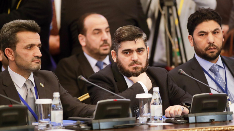 Mohammed Alloush, center, head of a Syrian opposition delegation, and other members attend talks on Syrian peace in Astana, Kazakhstan, Monday, Jan. 23, 2017. The talks are the latest attempt to forge a political settlement to end a war that has by most estimates killed more than 400,000 people since March 2011 and displaced more than half the country's population. (AP Photo/Sergei Grits)
